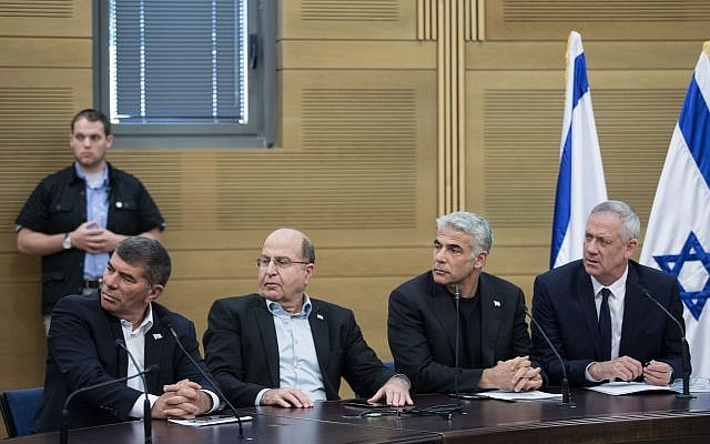 Blue and White party leaders (R-L) Benny Gantz, Yair Lapid, Moshe Ya'alon, and Gabi Ashkenazi, during a faction meeting at the Knesset on May 20, 2019. (Hadas Parush /Flash90)