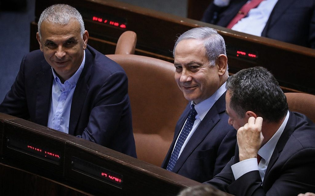Prime Minister Benjamin Netanyahu (C) is seen during a Knesset vote to revoke a law limiting the number of government ministers, on May 20, 2019. (Noam Revkin Fenton/Flash90)