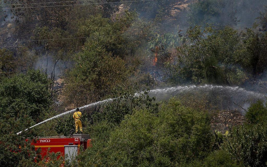 Fires rage across Israel amid heat wave, homes evacuated, roads closed