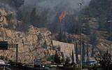 A fire raging next to the Romema neighborhood in Jerusalem on May 23, 2019. (Hadas Parush/Flash90)