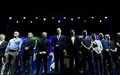 Blue and White party leaders Benny Gantz, Yair Lapid, Moshe Ya'alon and other opposition Knesset members take part in a demonstration outside the Tel Aviv Museum on May 25, 2019. The rally focused on Prime Minister Benjamin Netanyahu's efforts to advance legislation to avoid prosecution in three criminal cases he faces. (Tomer Neuberg/Flash90)