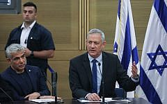 Blue and White party leaders MK Benny Gantz, right, and MK Yair Lapid at a faction meeting at the Knesset, on May 27, 2019. (Yonatan Sindel/Flash90)