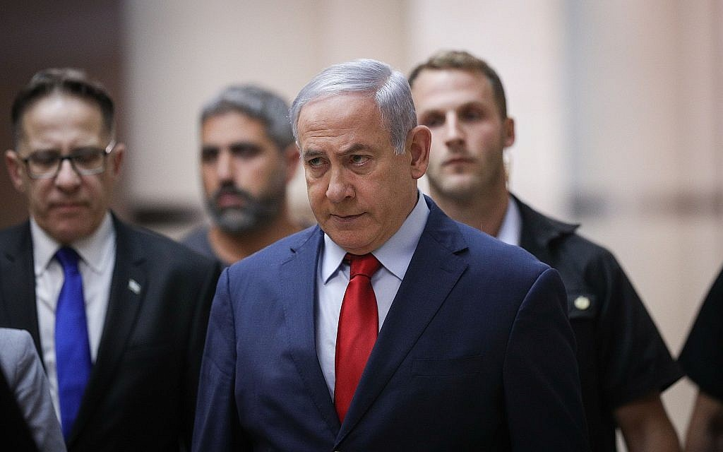 Prime Minister Benjamin Netanyahu walks to a party meeting in the Knesset in Jerusalem on May 29, 2019. (Yonatan Sindel/Flash90)
