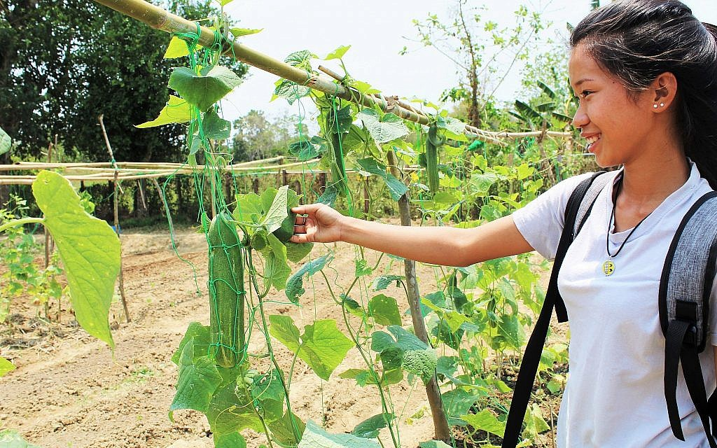 Htoi Send Mai in the school garden at the Ake Eco Farm and Sustainable Development Learning Center near Myitkyina, Myanmar.  (Emily Fishbein/Times of Israel)
