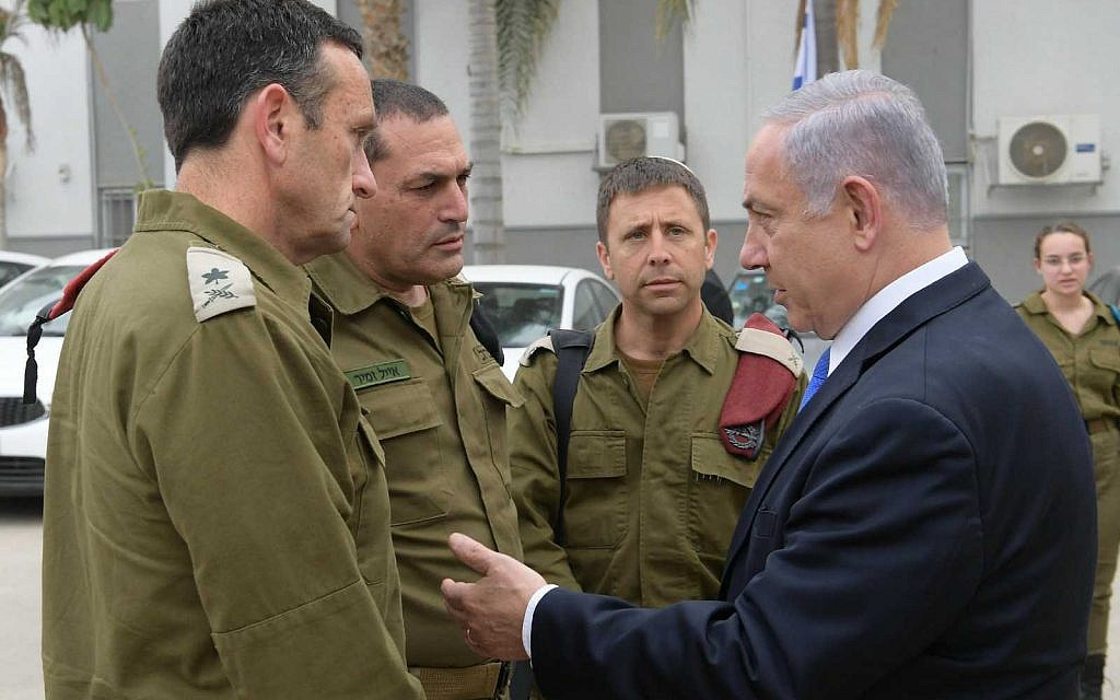 Prime Minister Benjamin Netanyahu (R) with IDF commanders after a security briefing in Beersheba, May 6, 2019. (Amos Ben Gershom/ GPO)