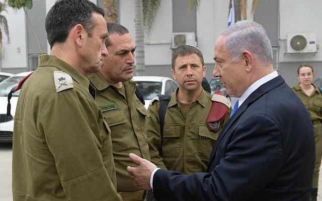 Prime Minister Benjamin Netanyahu (R) with IDF commanders after a security briefing in Beersheba, May 6, 2019. (Amos Ben Gershom/ GPO)