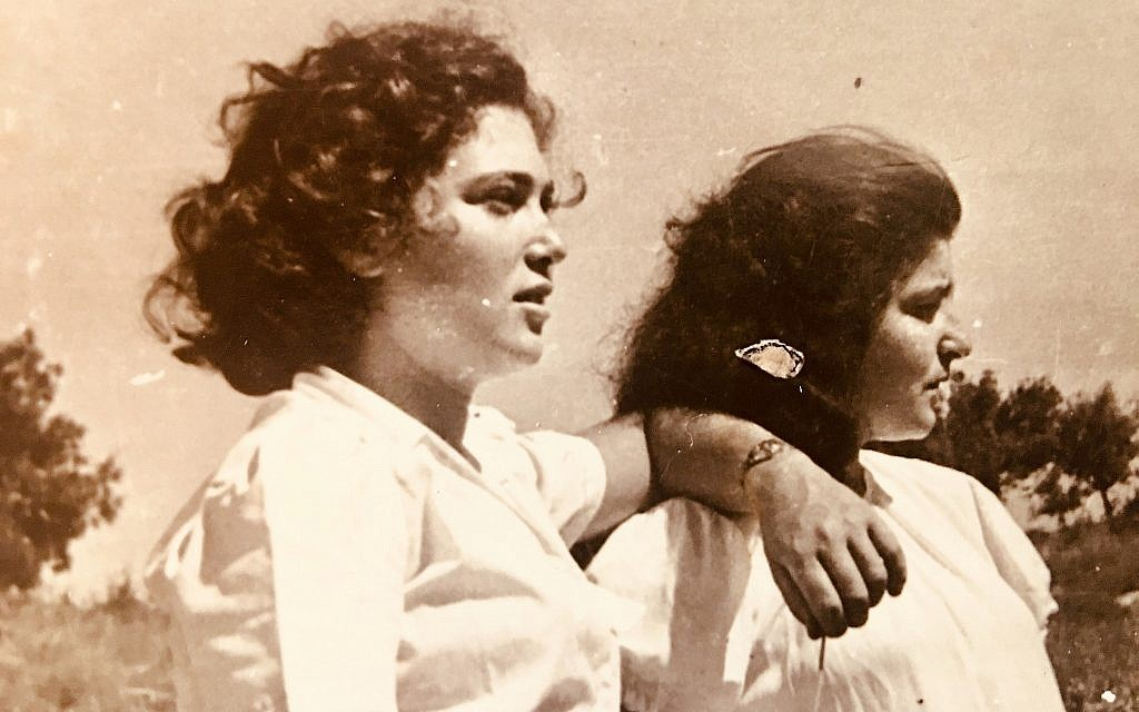 Ella Ben-David, left, with a fellow 'girl' during her service with the Palmach. (Courtesy)