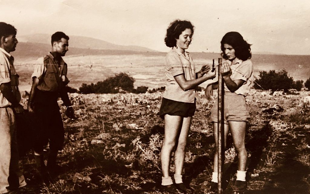 Ella Ben-David, center, puts up a barbed-wire fence as part of her Palmach service. (Courtesy)