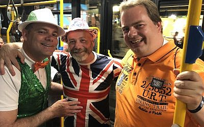 Bob Green (left), Robert Cameron and Pascal Rissewijick, all in Israel for Eurovision 2019, on a shuttle to the second semifinal on Thursday night, May 16, 2019 (Jessica Steinberg/Times of Israel)