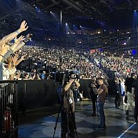 Israeli fans roar for Kobi Marimi, the Israeli contestant for Eurovision 2019, singing 'Home,' at a Friday dress rehearsal for the May 18, 2019 show (Jessica Steinberg/Times of Israel)