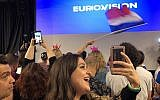 Fans at the Eurovision press screening in the Tel Aviv Expo on May 18, 2019 (Jessica Steinberg/Times of Israel)