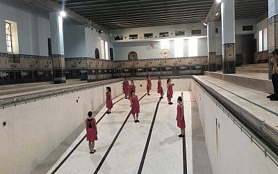 A rehearsal of one of the dances in 'Body -- Dance -- Place' at the historic, now empty, YMCA pool in Jerusalem (Jessica Steinberg/Times of Israel)