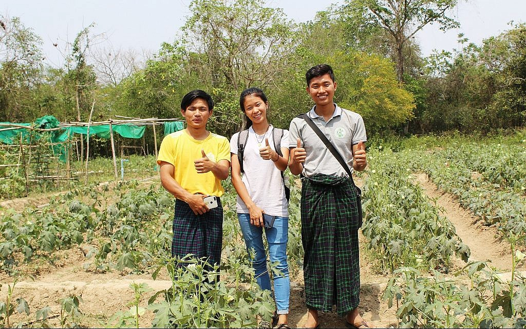 From left, Jat Tu Seng, Htoi Send Mai, and Dumdaw Naw Zet at the Ake Eco Farm and Sustainable Development Learning Center near Myitkyina, Myanmar. (Emily Fishbein/Times of Israel)