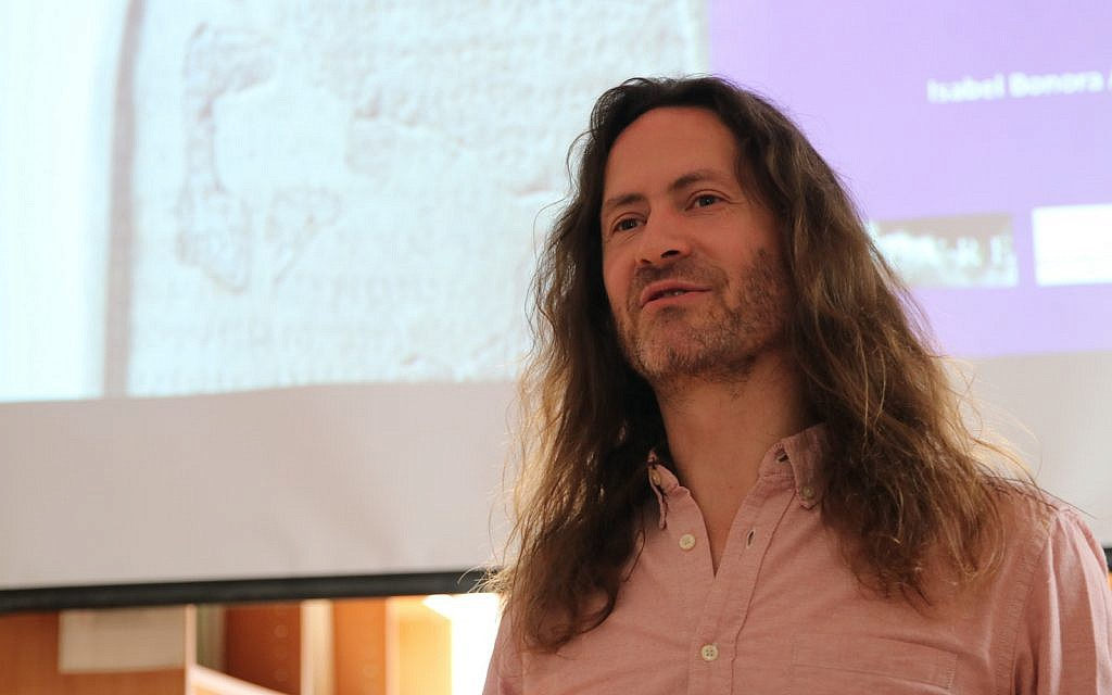 Scholar Michael Langlois lectures on the Mesha Stele at the French Research Center in Jerusalem on November 29, 2018. (Matthew Morgenstern)