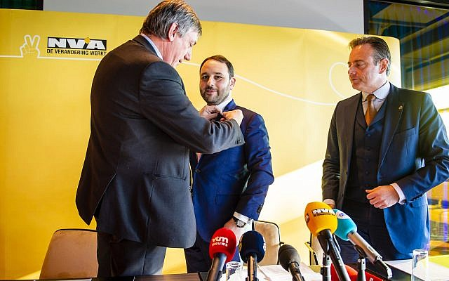 Michael Freilich, center, at a press conference in Antwerp Belgium announcing his entry into politics on January 21 2019. (Courtesy photo via JTA)