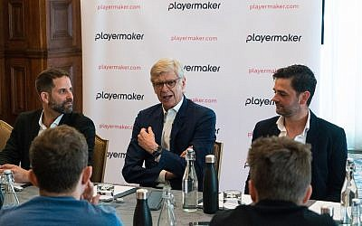 PlayerMaker's CEO Guy Aharon, left. former Arsenal manager Arsène Wenger, center, and Yuval Odem the COO of PlayerMaker. (Woody Rankin)