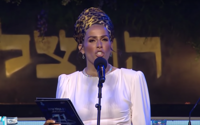 Linor Abargil presents Israel's annual Independence Day torch lighting ceremony at Mount Herzl in Jerusalem on May 8, 2019. (Screen capture: YouTube)