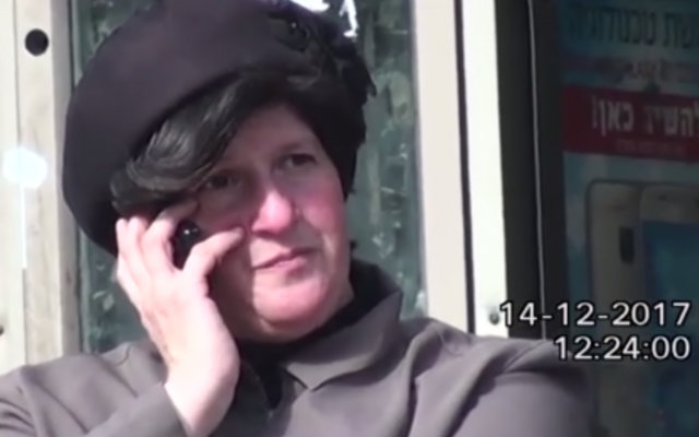 A private investigator tagged Malka Leifer as she spoke on the phone, while sitting on a bench in Bnei Brak, on December 14, 2017. (Screen capture/YouTube)
