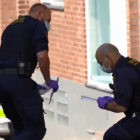 Police gather evidence at the scene of a stabbing in the Swedish city of Helsingborg in which a Jewish woman was reportedly seriously injured, May 14, 2019. (Screen capture: Aftonbladet)