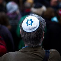 A man wears a kippa at a demonstration against an anti-Semitic attack in Berlin, Germany, April 25, 2018. (AP Photo/Markus Schreiber)