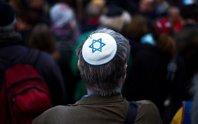 Illustrative: A man wears a kippah at a demonstration against an anti-Semitic attack in Berlin, Germany, April 25, 2018. (AP Photo/Markus Schreiber)