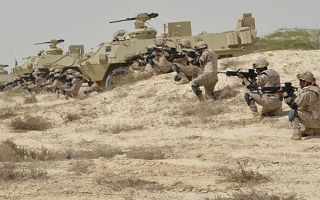 In this undated photo released by Saudi Press Agency, SPA, Saudi military personnel conduct military exercises dubbed Gulf Shield One in Saudi Arabia. (Saudi Press Agency via AP)