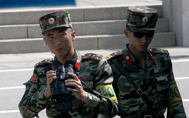 North Korean soldiers look at the South side at the border village of Panmunjom in the Demilitarized Zone, South Korea, May 1, 2019. (AP Photo/Lee Jin-man)