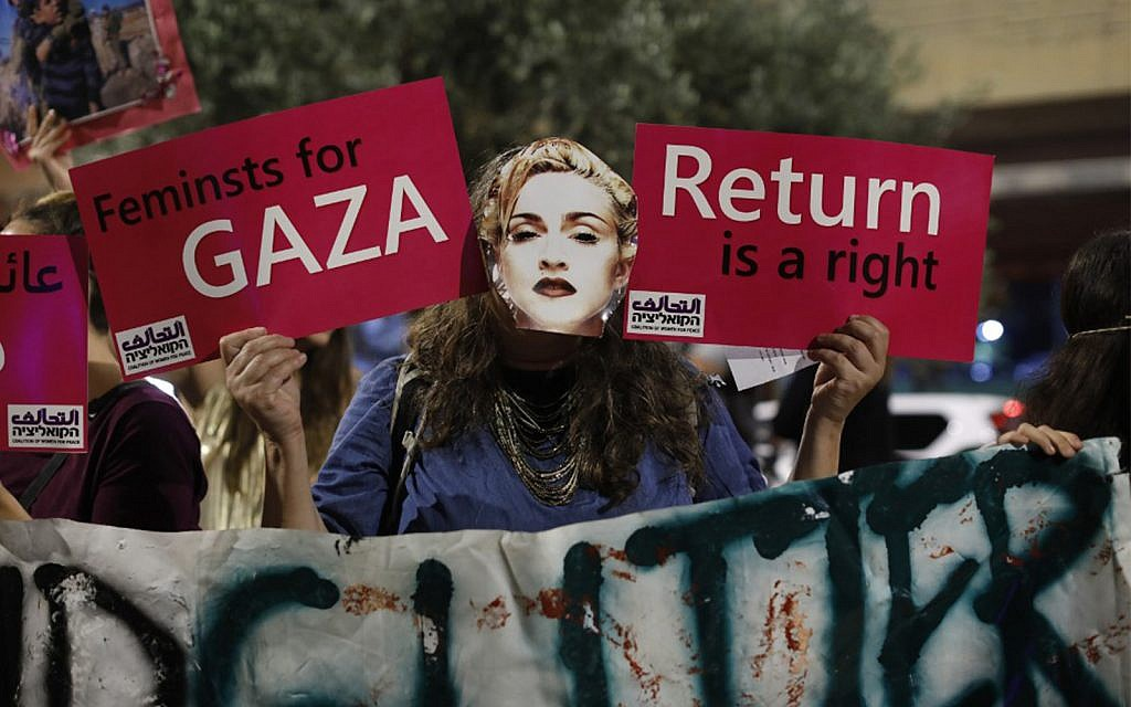 A demonstrator wearing a mask, bearing the likeness of American singer Madonna, during a protest calling for a boycott of the 2019 Eurovision Song Contest in Tel Aviv, May 18, 2019. (Ahmad GHARABLI/AFP)