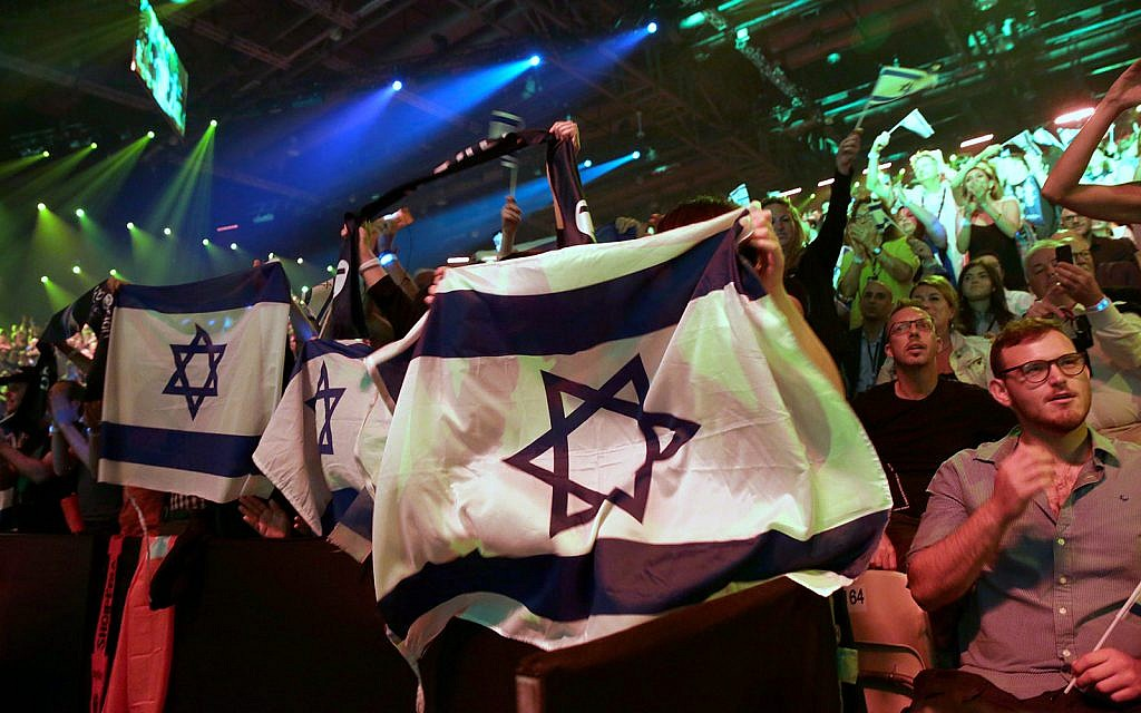 Spectators watch the 2019 Eurovision Song Contest grand final in Tel Aviv, May 18, 2019. (AP Photo/Sebastian Scheiner)