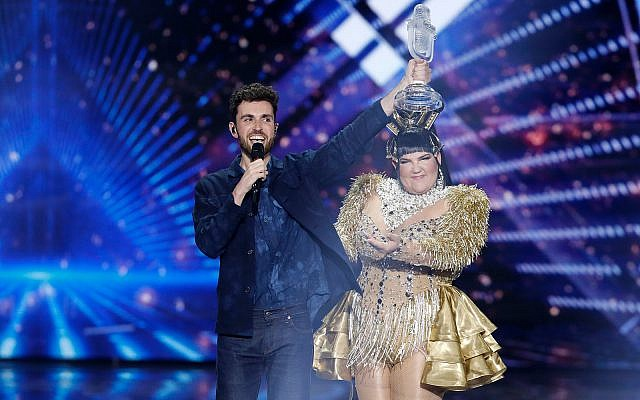 "Duncan Laurence of the Netherlands celebrates winning the 2019 Eurovision Song Contest with the song ""Arcade"" in Tel Aviv, May 18, 2019. Behind him is 2018's winner, Israeli singer Netta Barzilai. (AP Photo/Sebastian Scheiner)"
