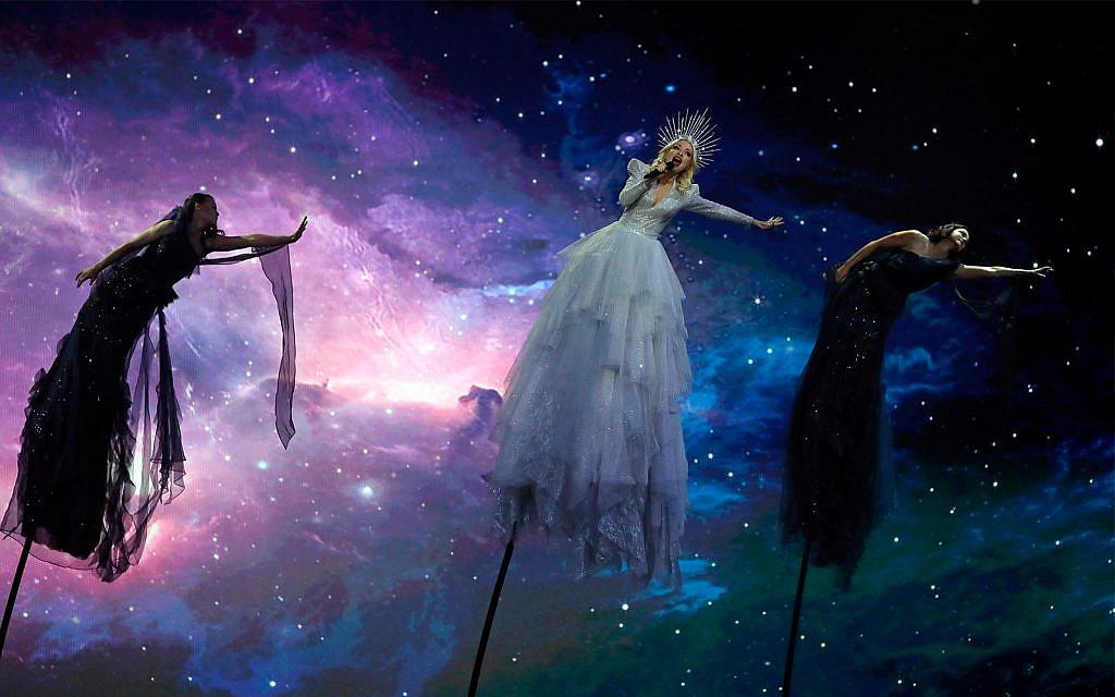 "Kate Miller-Heidke of Australia, center, performs the song ""Zero Gravity"" during the 2019 Eurovision Song Contest grand final in Tel Aviv, May 18, 2019. (AP Photo/Sebastian Scheiner)"