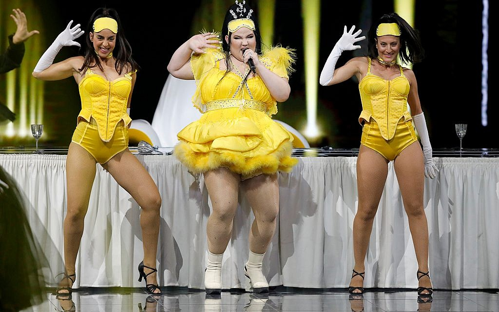 "Israeli Netta Barzilai, the winner of the 2018 Eurovision Song Contest performs ""Nana Banana"" during the 2019 Eurovision Song Contest grand final in Tel Aviv, May 18, 2019. (AP Photo/Sebastian Scheiner)"