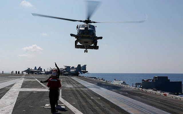 In this photo released by the US Navy, a Sea Hawk helicopter prepares to land on the flight deck of the USS Abraham Lincoln aircraft carrier in the Adriatic Sea, May 2, 2019. (US Navy/Michael Singley)