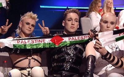 Iceland's Hatari holds up Palestinian flags during Eurovision in Tel Aviv, May 19, 2019. (YouTube screenshot)