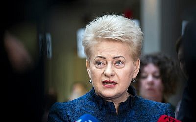 Lithuania's President Dalia Grybauskaite speaks to the members of press at a polling station during the advance presidential elections in Vilnius, Lithuania, May 7, 2019. (AP Photo/Mindaugas Kulbis)