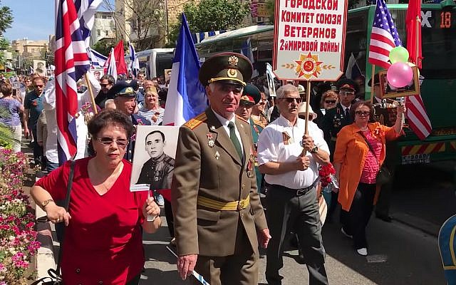 Red Army veterans and supporters march in Haifa for Victory Day, celebrating victory over the Nazi regime in World War II, on May 10, 2019. (YouTube screenshot)