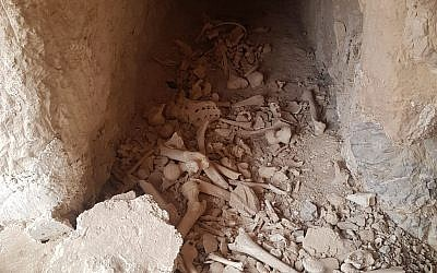 Remains of believed Second Temple-era Jews, exposed when their tombs near Jericho were damaged, are re-interred at the nearby Kfar Adumim settlement on May 21, 2019. (Courtesy Regavim)