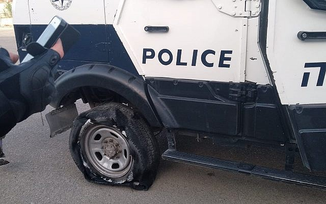Illustrative photo: An Israel Police vehicle after its tires are slashed allegedly by settlers near Yitzhar in the northern West Bank on May 25, 2019. (Israel Police)
