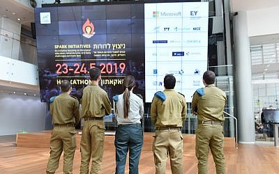 IDF soldiers from the C4I and Cyber Defense Directorate took part in the  Spark Hackathon, held in May 23-24, 2019, to preserve the memory of the Holocaust and increase the quality of life of the survivors (IDF spokesperson's unit)