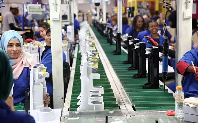 Employees on an assembly line in SodaStream's Rahat factory on May 27, 2019. (courtesy SodaStream)