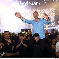 SodaStream CEO Daniel Birnbaum dances with employees during a Ramadan iftar breakfast at the Rahat factory on May 27, 2019. (courtesy SodaStream)