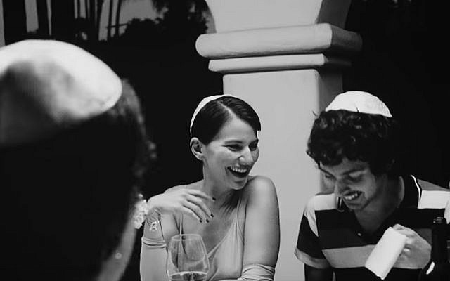 """A Passover seder seen in  Vampire Weekend's """"This Life"""" music video. (YouTube screenshot)"""