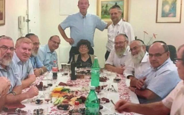 A Torah study session at Martha Motzen's home in Petah Tikva (Channel 12 screenshot)