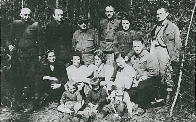Yehuda Bielski (sitting second row right) with some Bielski Partisans, (Naliboki Forest, Belarus, 1943)