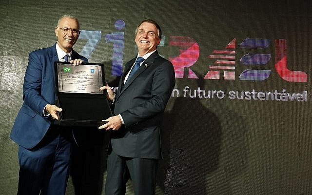 Brazilian President Jair Bolsonaro (R) receives a plaque marking Israel's 71st birthday at an event in the Israeli Embassy in Brasilia on May 22, 2019 (Courtesy of Israeli embassy in Brasilia)