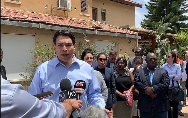 Israel's Ambassador to the UN, Danny Danon, briefing fellow ambassadors to the UN May 7, 2019, during a tour of homes and buildings in the coastal city of Ashkelon hit by rockets fired from Gaza over the weekend.  (Mission of Israel to the UN)