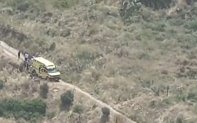 Rescuers on a hillside near Kibbutz Heftsiba in northern Israel on May 4, 2019 after an ATV accident that left three dead and one seriously hurt. (Channel 12 screen capture)
