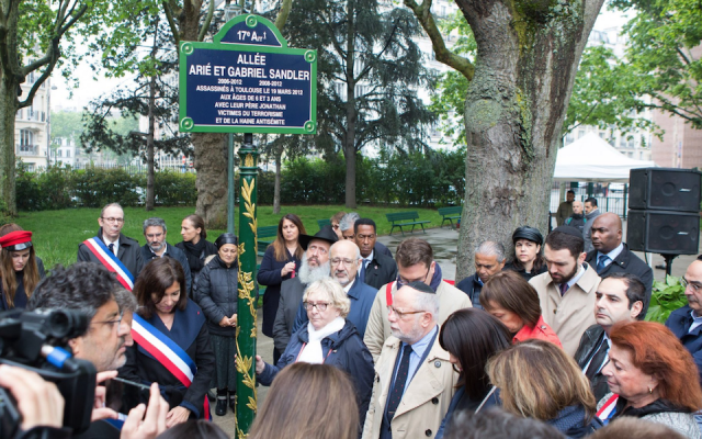 Paris Mayor Anne Hidalgo, left in sash, attends a ceremony honoring the victims of the 2012 Toulouse Jewish school shooting, on May 19, 2019, by naming two alleys in the city after the three victims. (Anne Hidalgo/Twitter/via JTA)
