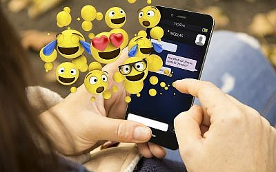 Illustrative - Emoji use on a smartphone. (Mlindri, Getty Images)
