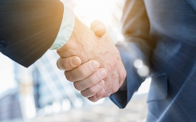 Illustrative image of a handshake (stnazkul; iStock by Getty Images)